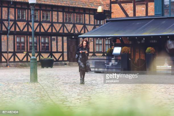 pretty touritst woman with map searching for direction - malmo stock pictures, royalty-free photos & images