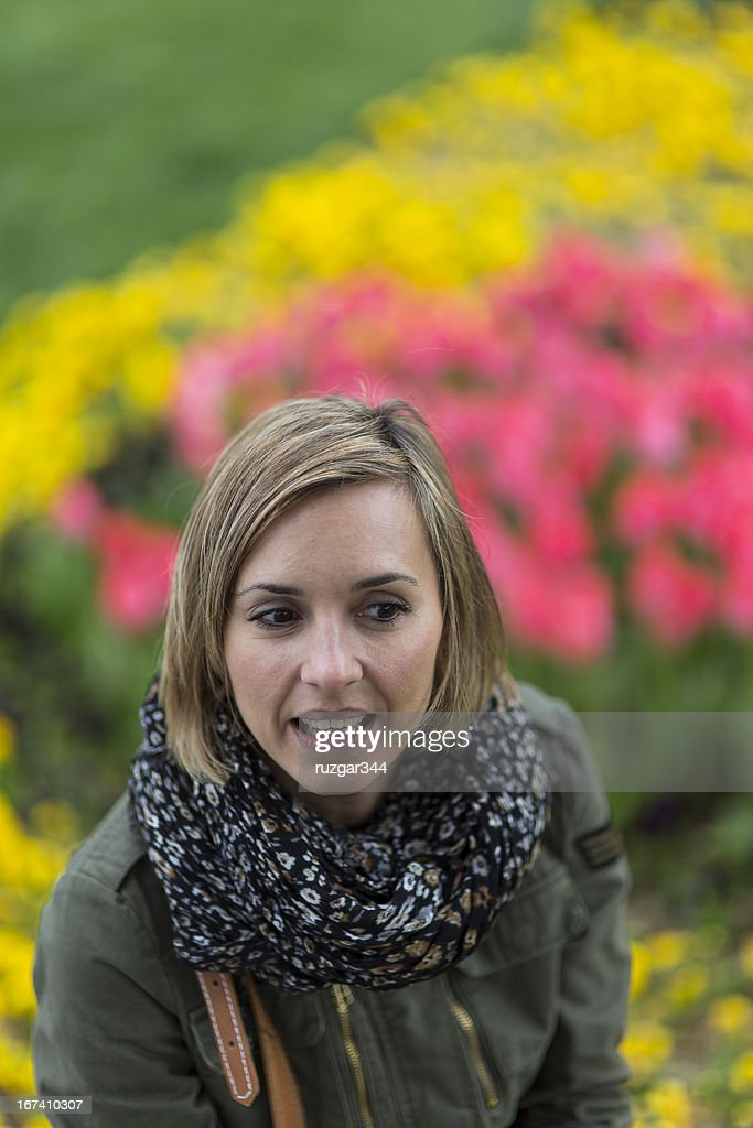Pretty traveller woman in a colorful spring park : Stock Photo