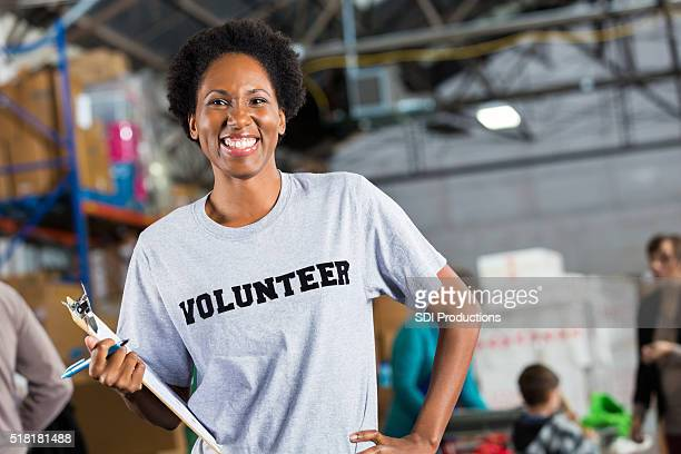 Pretty volunteer at food and clothing drive