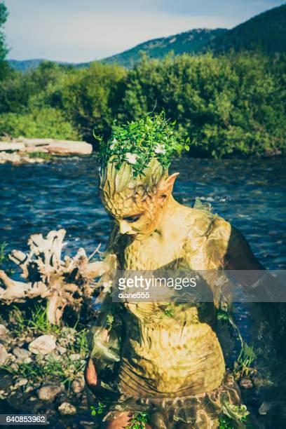 Pretty Water Nymph Fantasy Creature Near a Creek