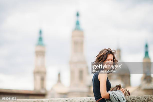 Pretty woman and big Cathedral in the background