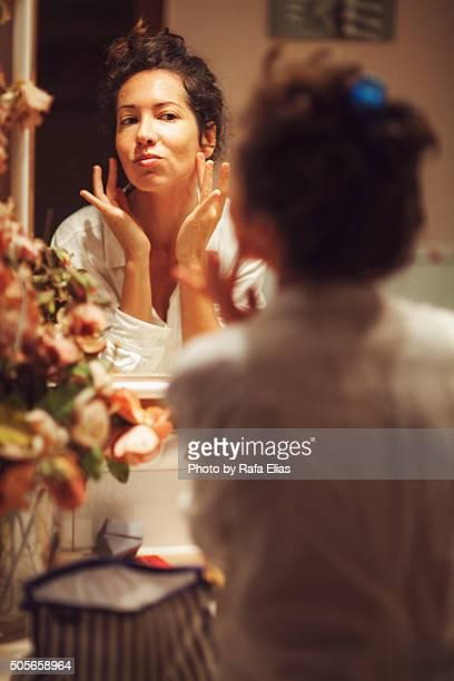 Pretty woman applying makeup