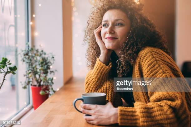 pretty woman at the cafe - mid adult woman sweater stock pictures, royalty-free photos & images