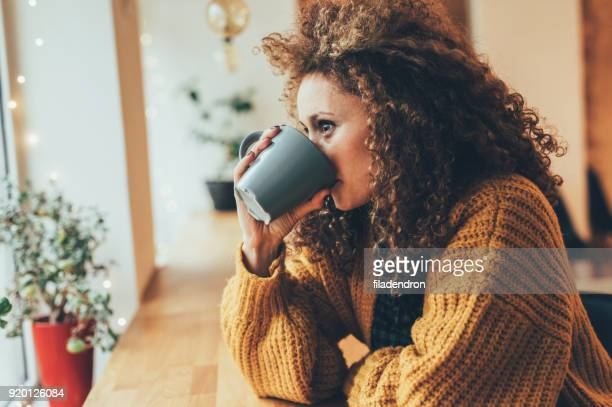 pretty woman at the cafe - sweater stock pictures, royalty-free photos & images