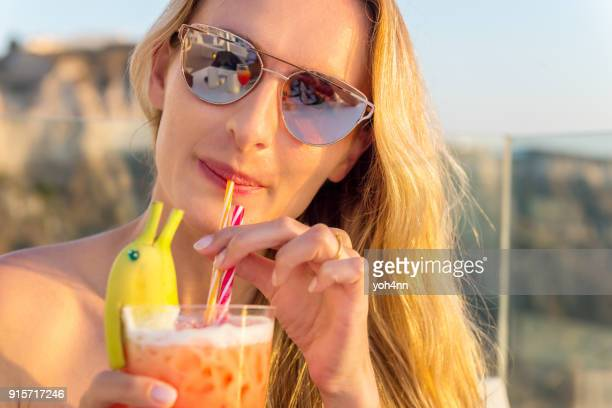 Pretty woman drinking funny cocktail
