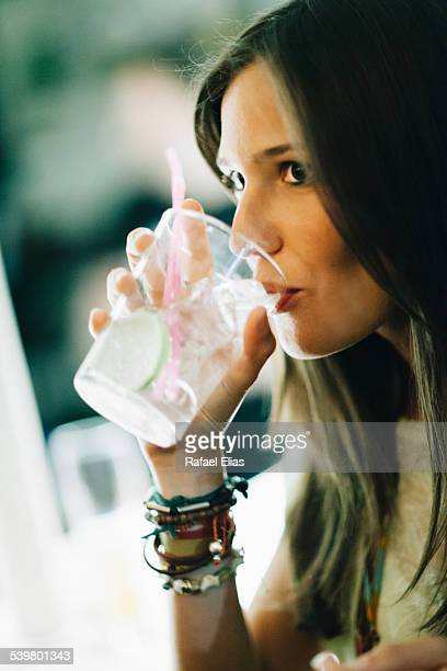 Pretty woman drinking gin and tonic