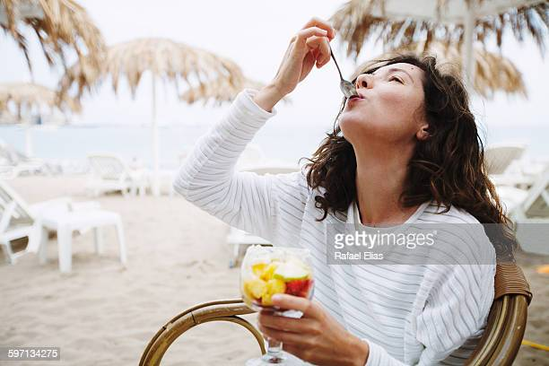 Pretty woman eating some fruit