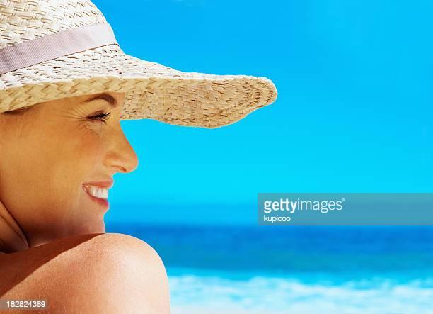 Pretty woman enjoying summer vacation on beach