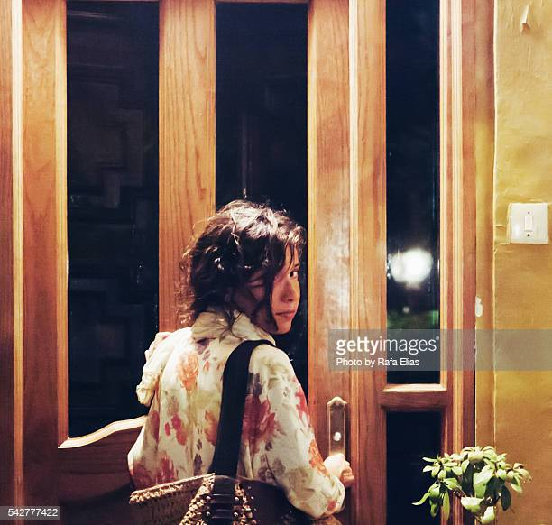 pretty woman entering home - knocking on door stock photos and pictures
