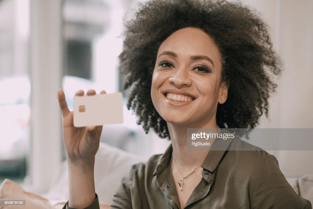 Pretty woman holding credit card : Stock Photo