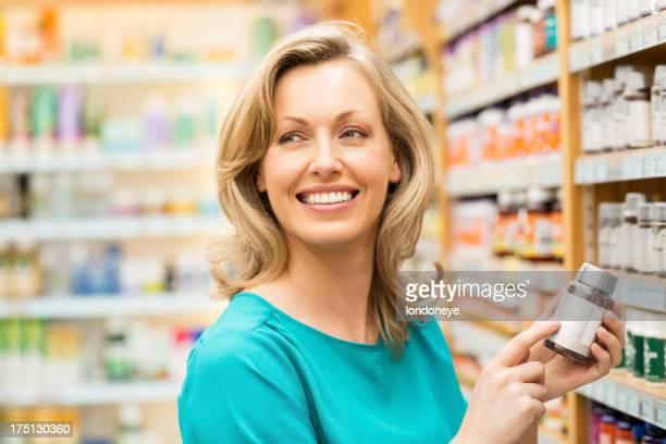 Pretty Woman Holding Pill Bottle