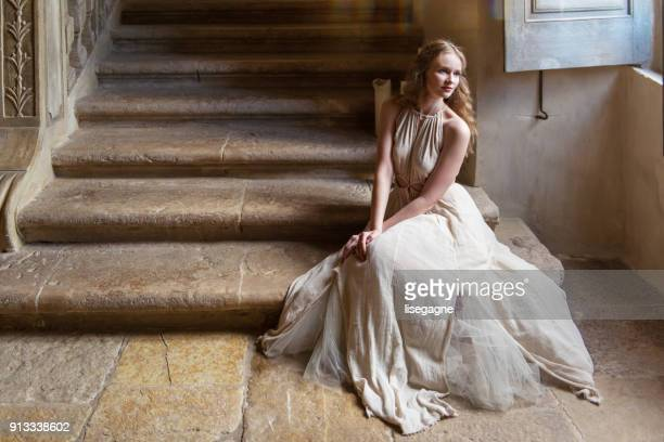 pretty woman in a castle - princess stock pictures, royalty-free photos & images