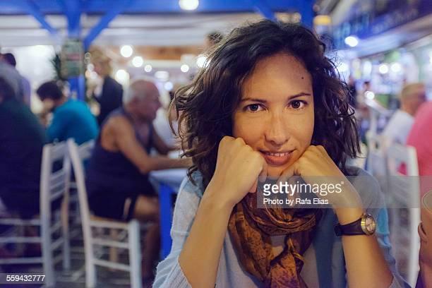 Pretty woman in terrace bar at night