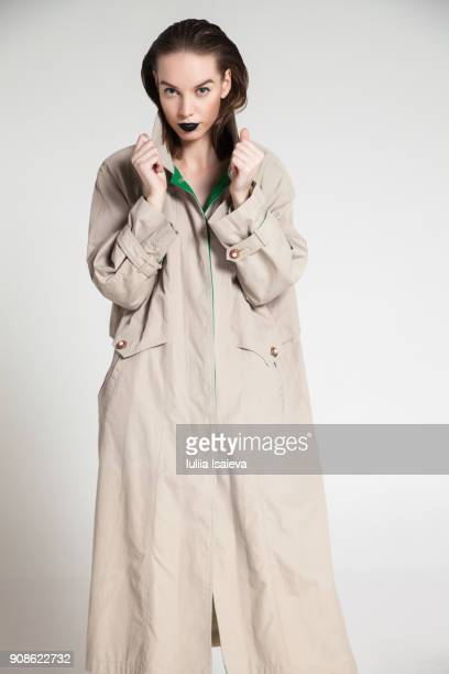 Pretty woman in trench coat