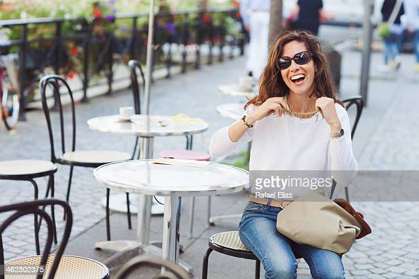 Pretty woman laughing in cafe