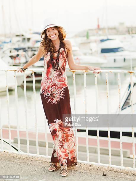 pretty woman leaning on fence - maxi dress stock pictures, royalty-free photos & images