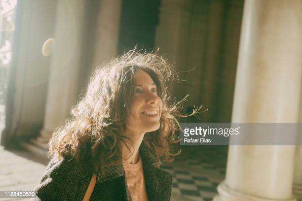 pretty woman looking up inside temple - respect stock pictures, royalty-free photos & images