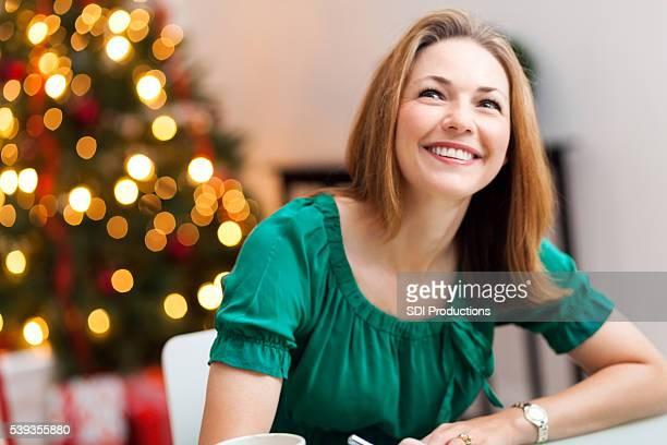 Pretty woman making Christmas list
