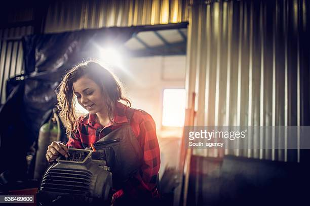 pretty woman mechanic - electric motor stock photos and pictures