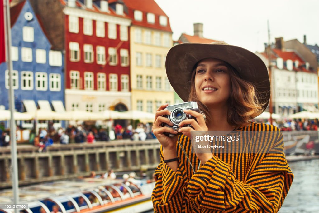 Pretty woman photographer in Nyhavn Copenhagen : Stock Photo