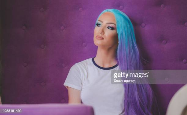 pretty woman - purple hair stock photos and pictures