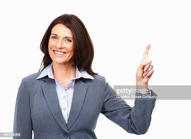 Pretty woman pointing up on white background