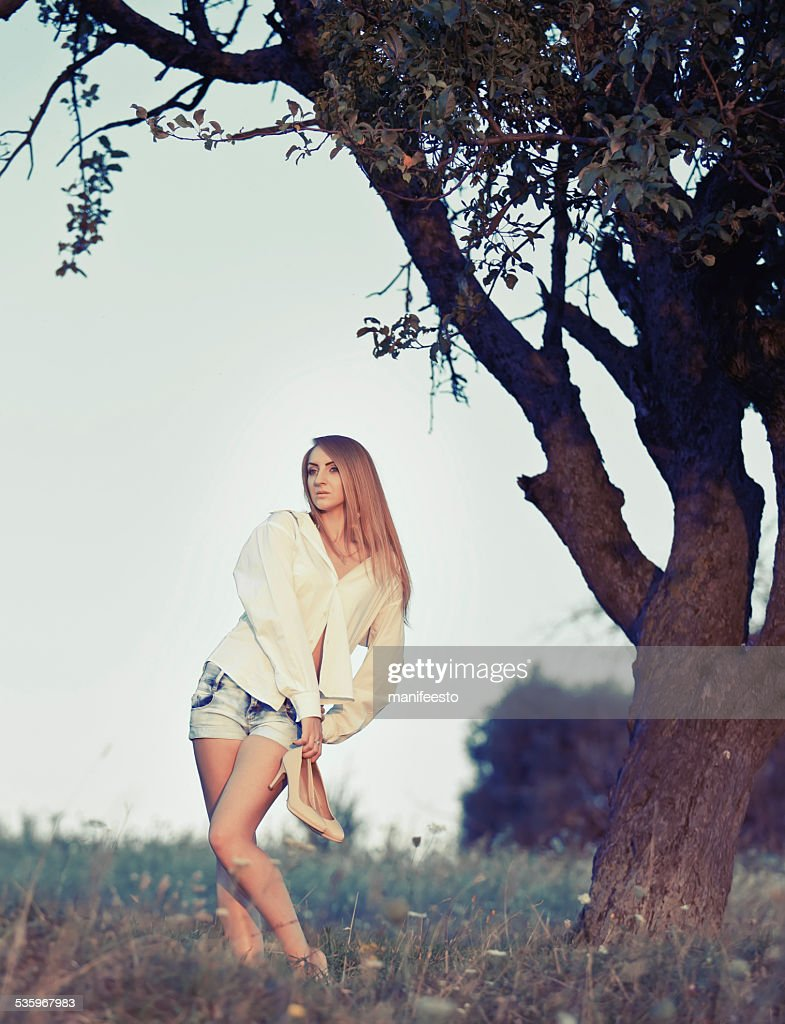 Pretty woman posing outside in summer garden. : Stock Photo