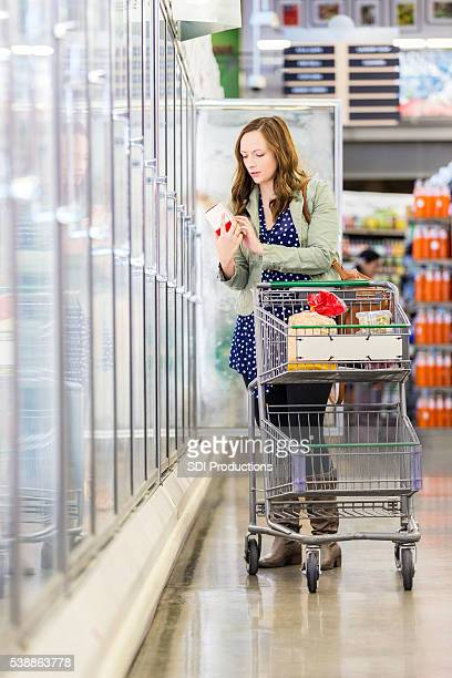 Pretty woman shopping for food