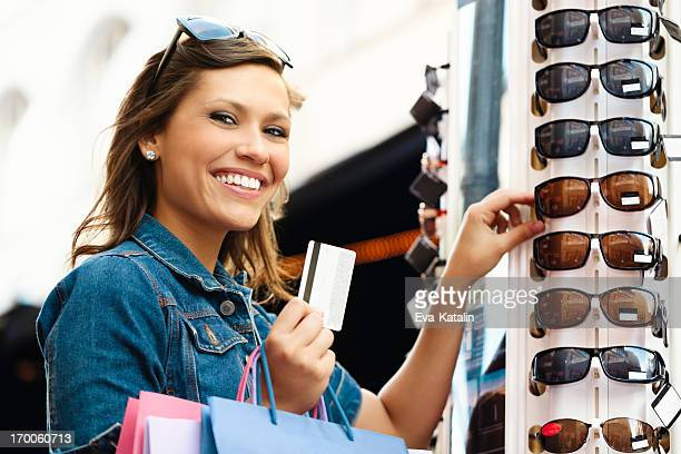 Pretty woman shopping sunglasses