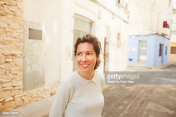 Pretty woman smiling in the street