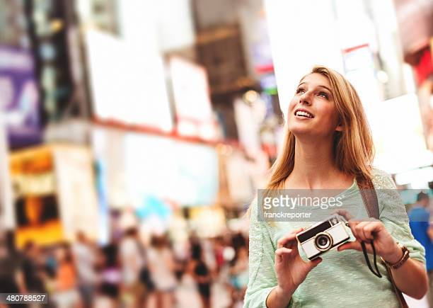 pretty woman smiling on times square