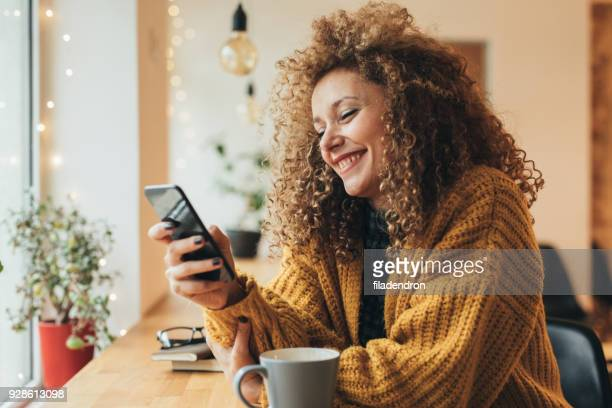 pretty woman texting on the phone - choosing stock pictures, royalty-free photos & images