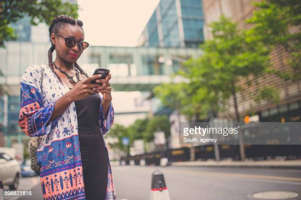 Pretty woman texting on the street