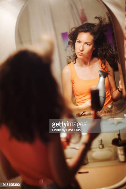 pretty woman using hairdryer in the bathroom - women in wet t shirts stock pictures, royalty-free photos & images