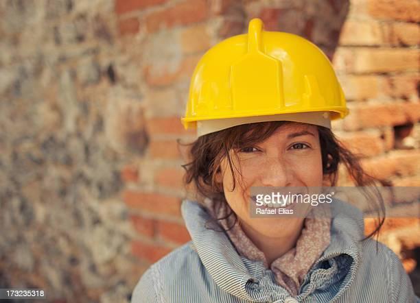 Pretty woman wearing safety helmet