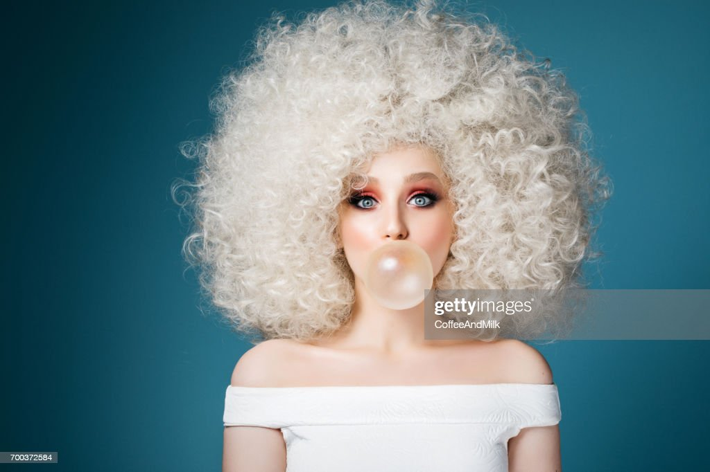 Pretty woman with extravagant hairstyle : Stock Photo