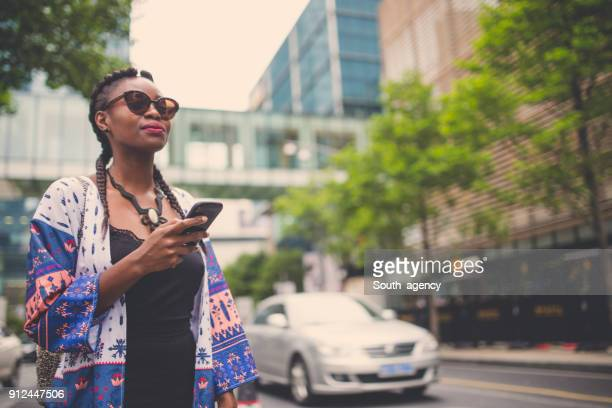 Pretty woman with phone on the street