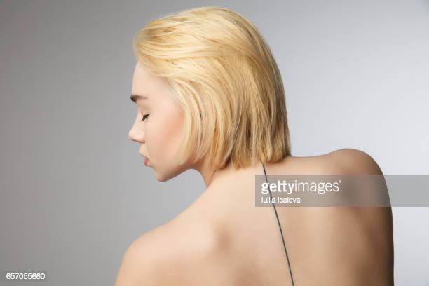 Pretty woman with thin line on back