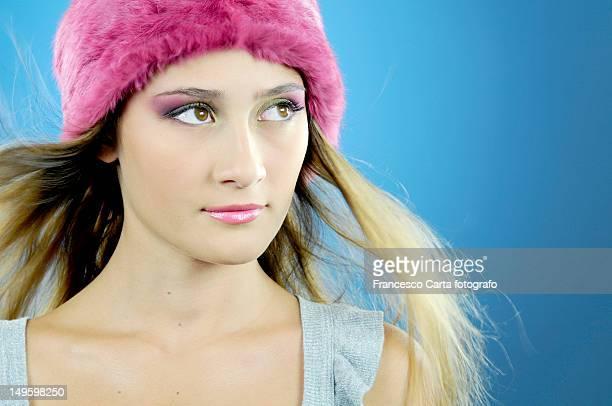 pretty woman with winter hat - tempio pausania stock-fotos und bilder