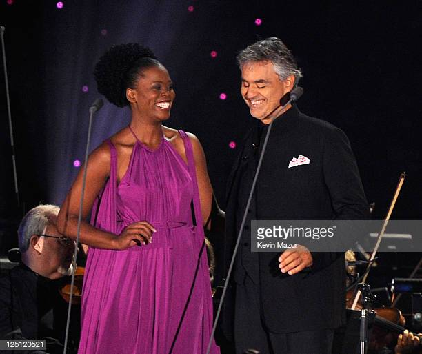 Pretty Yende and Andrea Bocelli perform at the Central Park Great Lawn on September 15 2011 in New York City