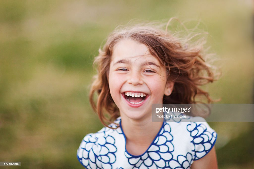 Pretty young girl laughing : Stock Photo
