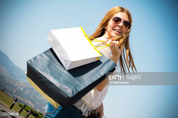 Pretty young girl with shopping bags