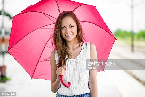 Pretty young girl with umbrella