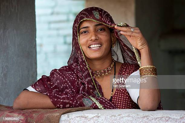 Pretty young Indian woman at home in Narlai village in Rajasthan Northern India