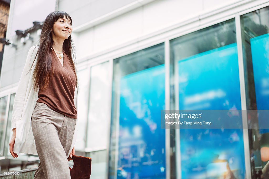Pretty young lady commuting joyfully : Stock Photo