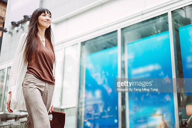 Pretty young lady commuting joyfully