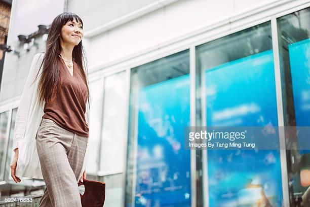 Pretty young lady commuting joyfully
