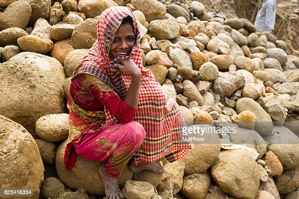 A pretty young lady having rest for a while at stone extraction site in Jaflong Sylhet Bangladesh on February 28 2015 Sylhet is a very resourceful...