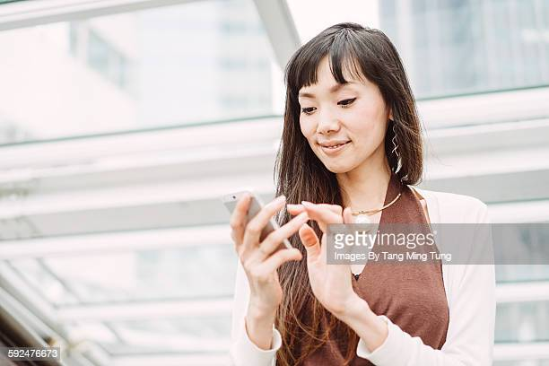 Pretty young lady using smartphone