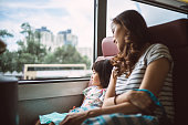 pretty young mom riding bus with